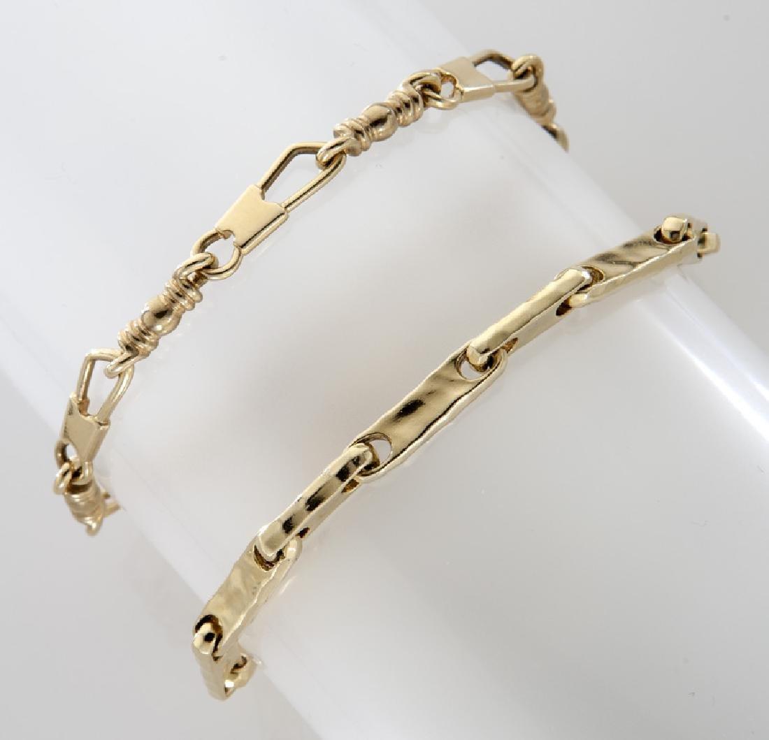 (2) 14K yellow gold link bracelets.