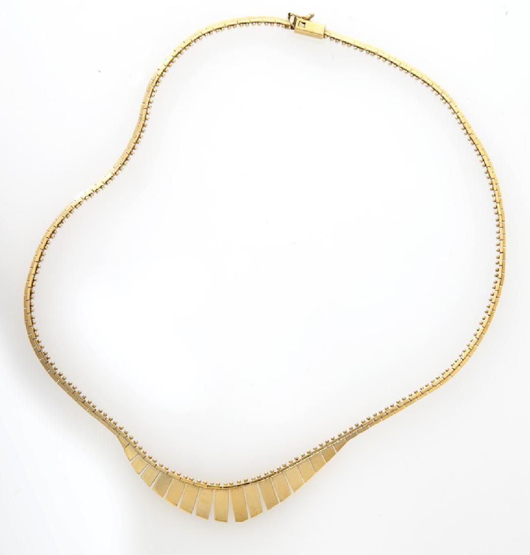 Italian 14K yellow gold necklace with fringe.