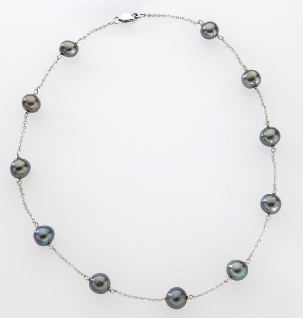18K gold and Tahitian cultured pearl necklace.