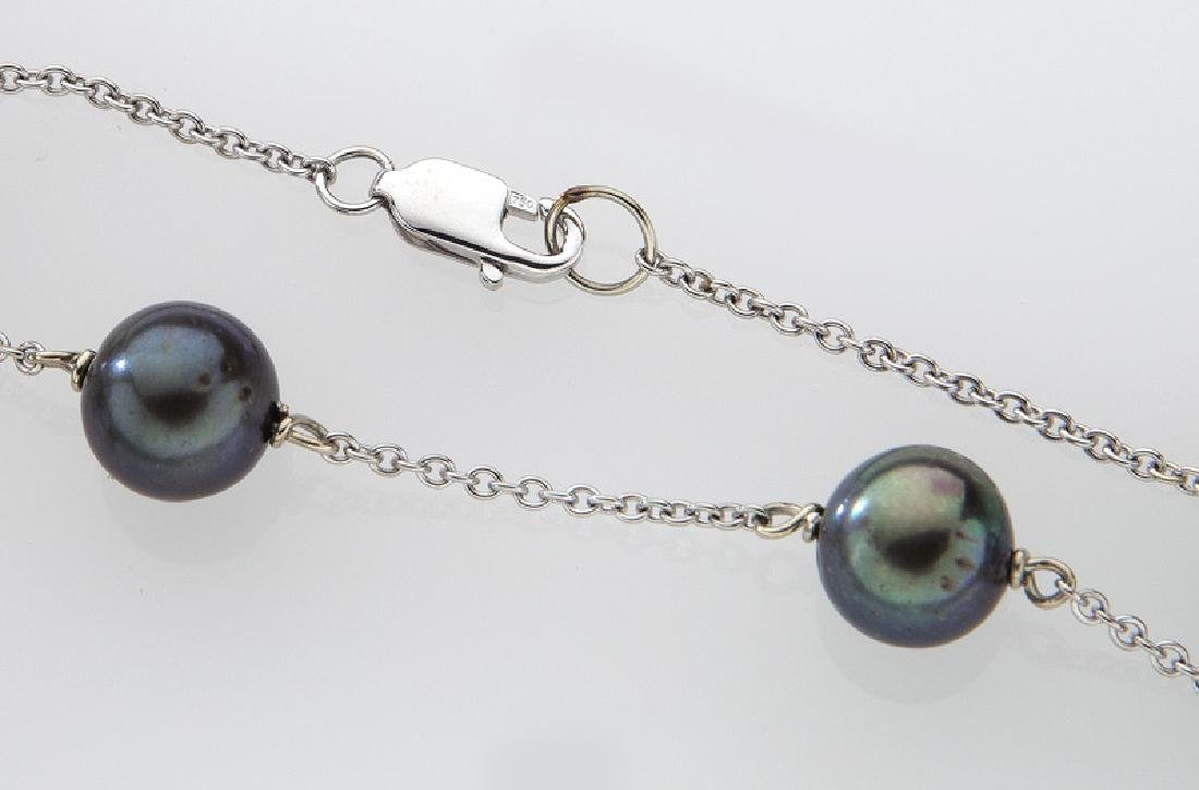 18K gold and Tahitian cultured pearl necklace. - 2