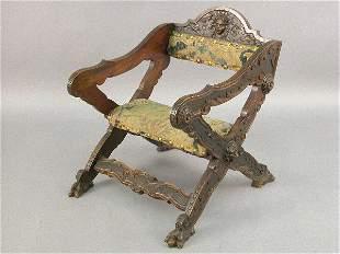 Italian carved walnut x-frame armchair w/ woman's