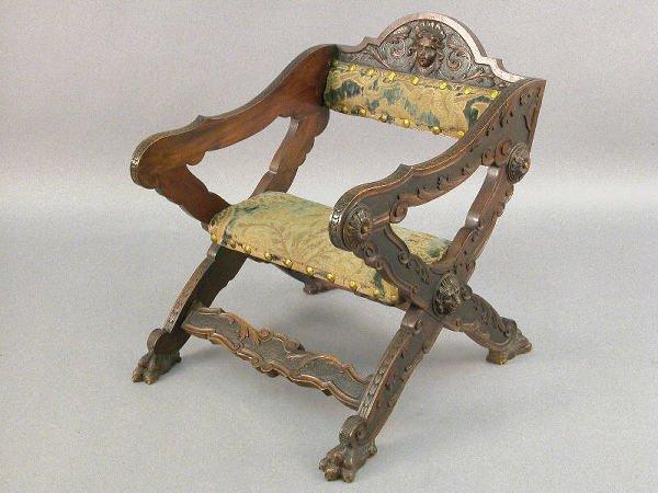12: Italian carved walnut x-frame armchair w/ woman's