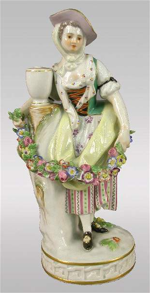 Marked Meissen figural of woman with garland.