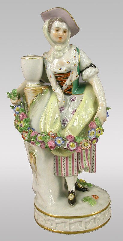 16: Marked Meissen figural of woman with garland.