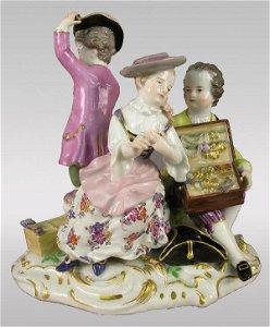 82: Marked Meissen figural group of salesman