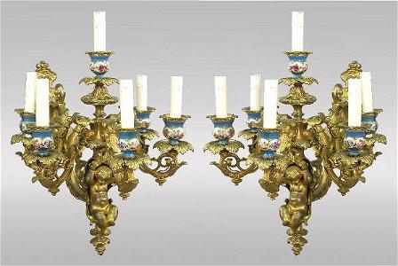 151: Pair gilt bronze figural sconces each with a
