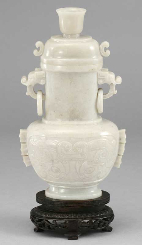 13: A Chinese carved white jadeite covered vase