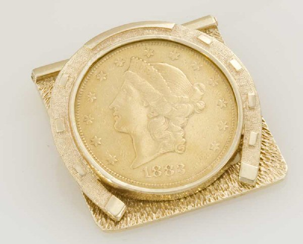 15: A 14K gold money clip with 1883 Liberty head coin,