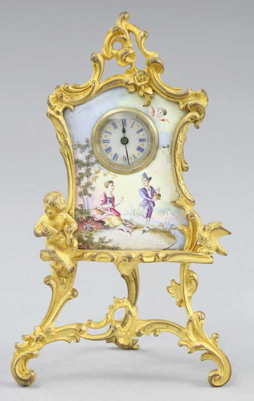 24: A miniature Limoges enamel boudoir clock in an