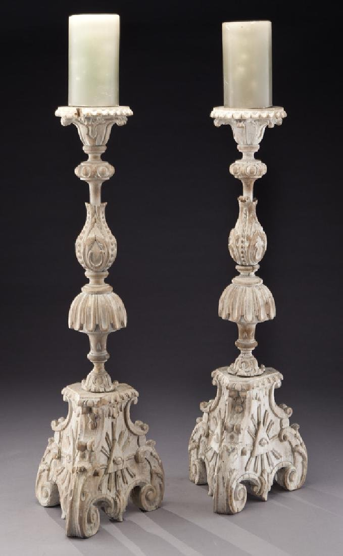 Pair of Italian carved wood pricket candle stands