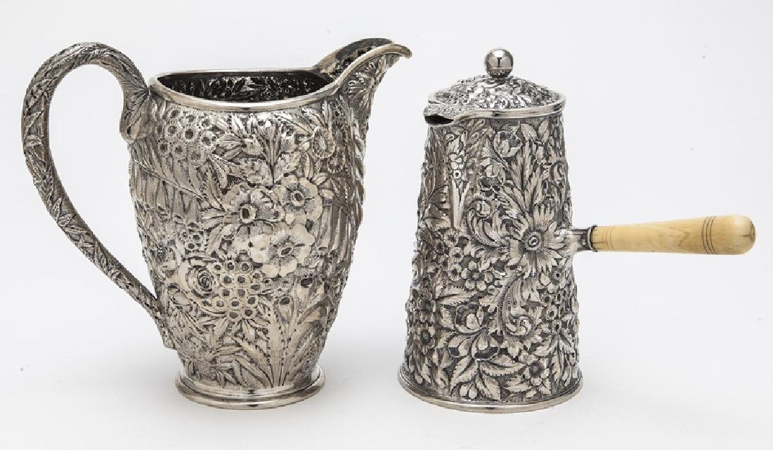 (2) Ornate American sterling silver pitchers,