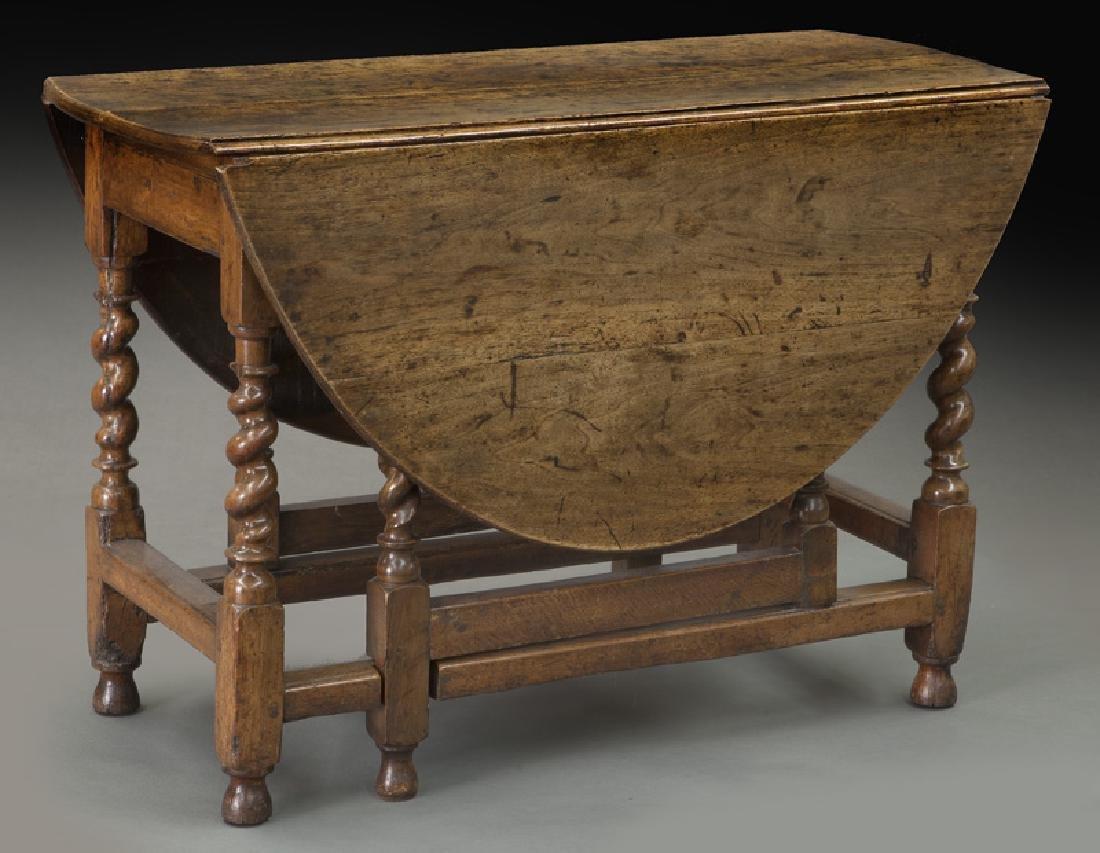 Early oak barley twist gateleg table,