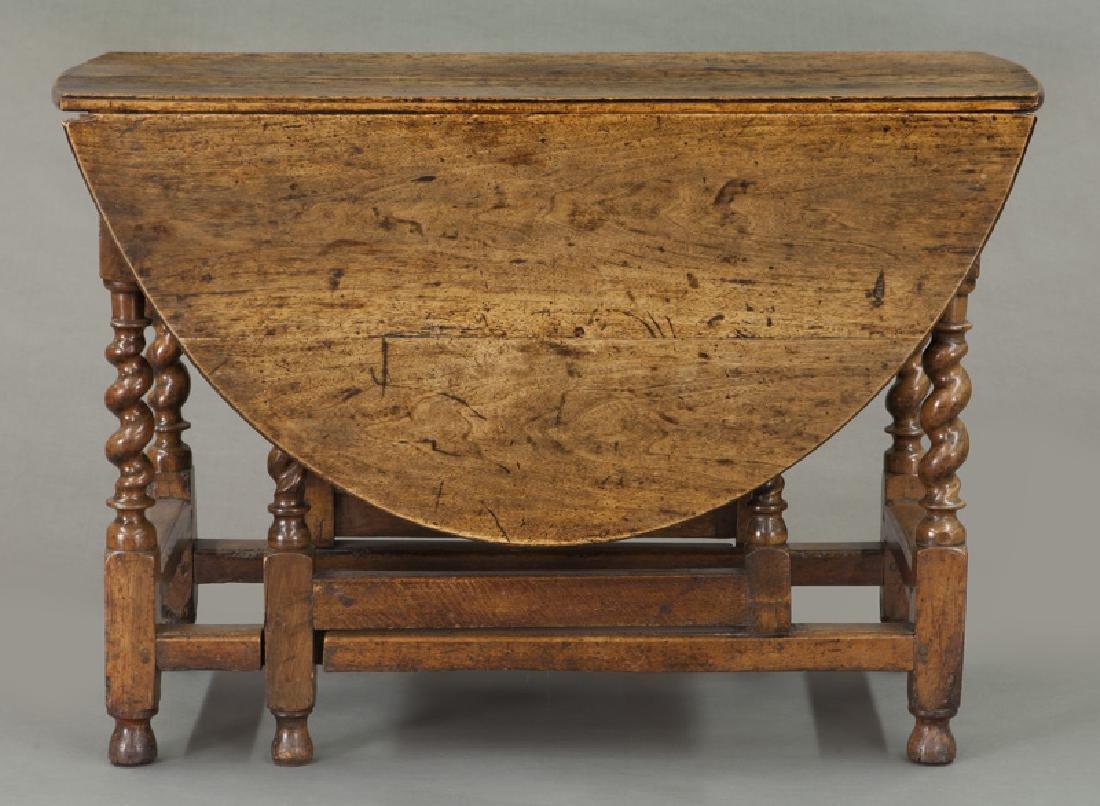 Early oak barley twist gateleg table, - 2