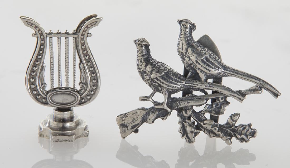 Four sets of silver place card holders; - 2