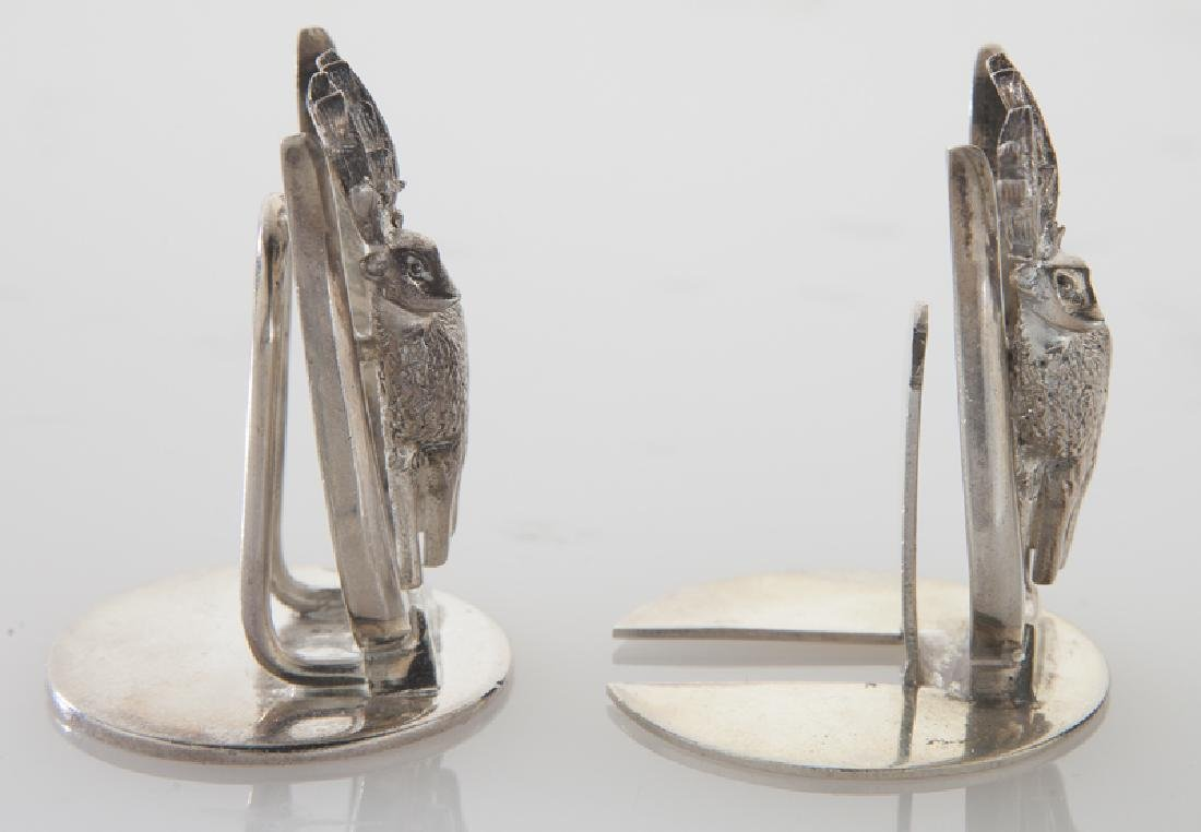 Four sets of silver place card holders; - 7