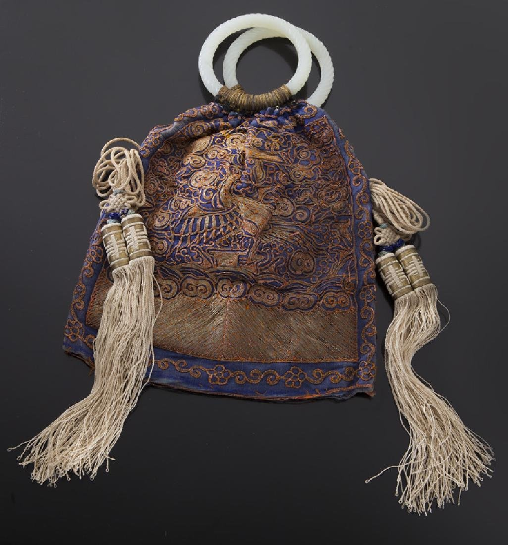 Chinese embroidery purse with jade handles.