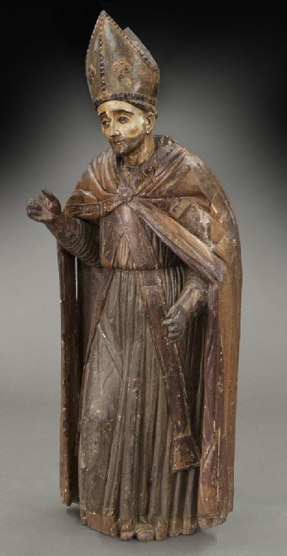 Early carved wood figure of a Bishop Saint,
