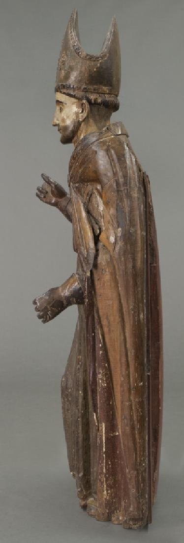 Early carved wood figure of a Bishop Saint, - 6