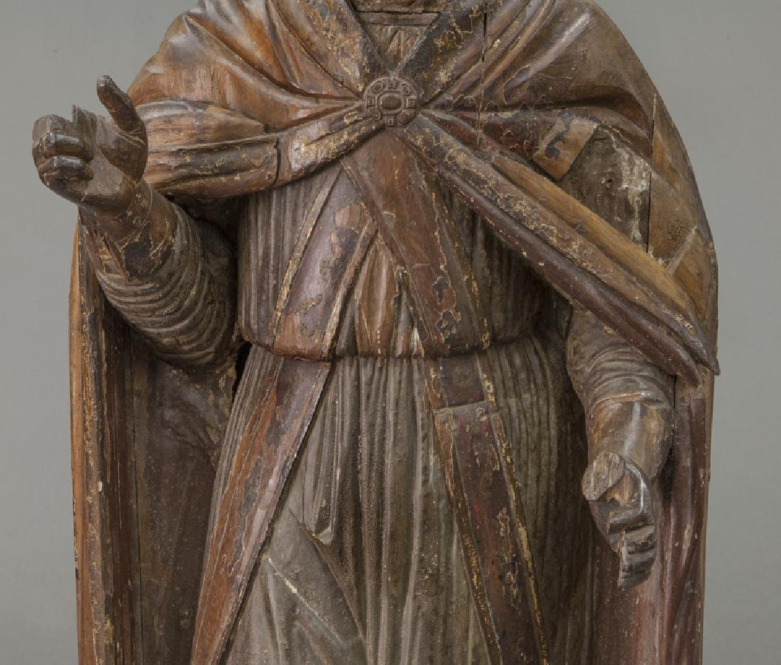 Early carved wood figure of a Bishop Saint, - 9
