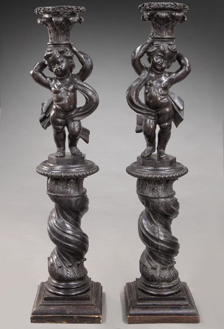 Pr. Portuguese carved wood figural torchieres,