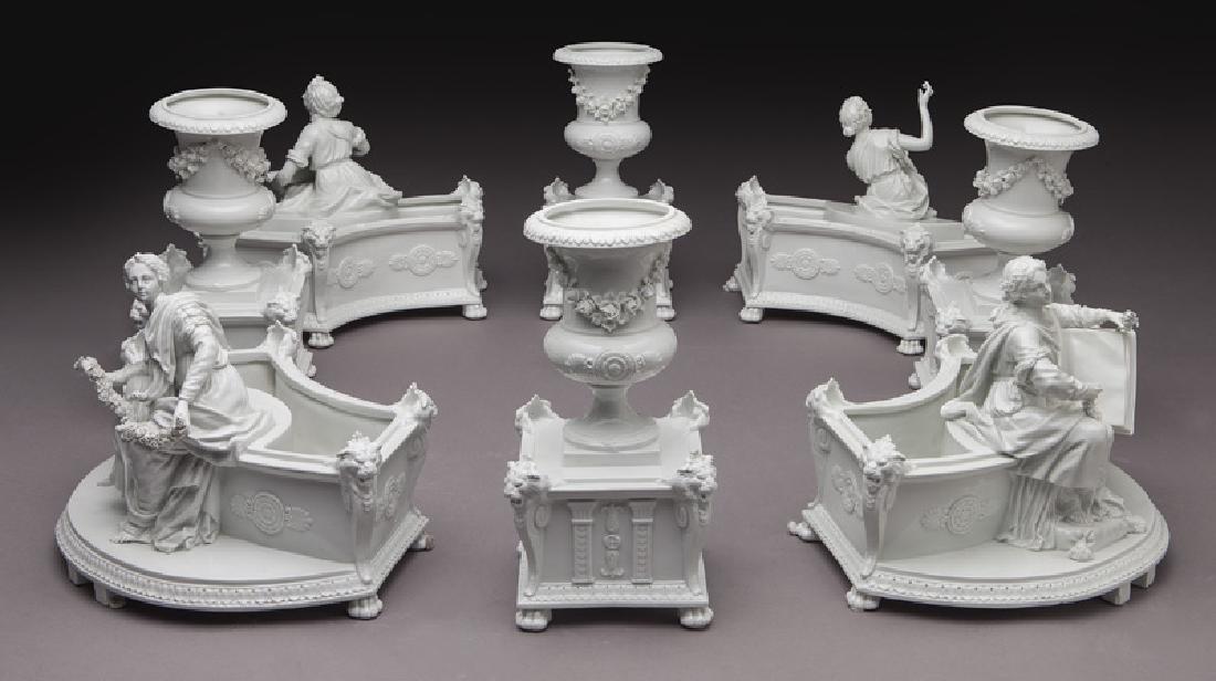 8 Pc. white porcelain figural centerpiece set