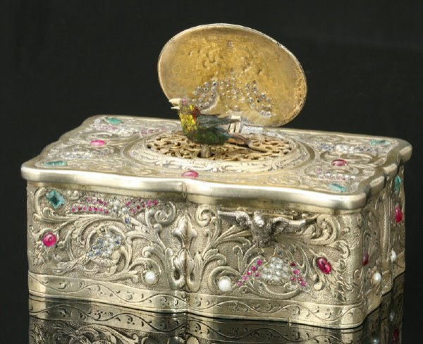 21: A Continental gilt silver jeweled singing bird box