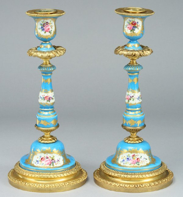 22: A pair of ormolu mounted Sevres style candlesticks