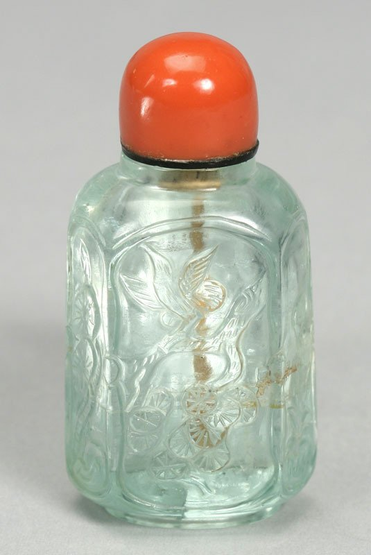 9: A carved aquamarine snuff bottle of hexagonal form