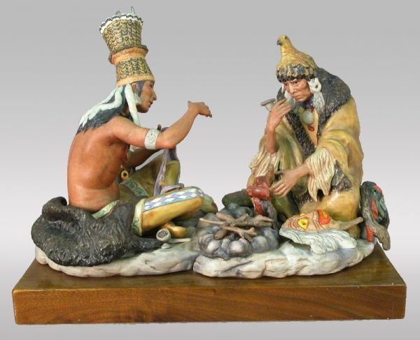 11: Signed Cybis porcelain of two seated indians