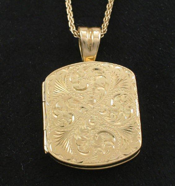 "17: 18K yellow gold scroll locket on 18"" chain."