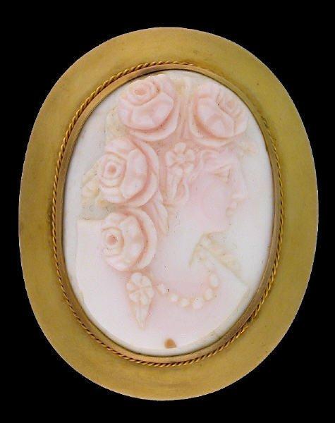 18: (2) coral cameo brooch / pendants.