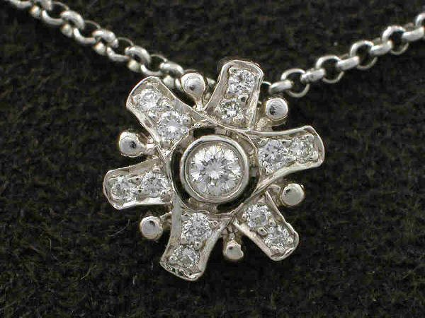 20: Diamond in platinum snowflake necklace