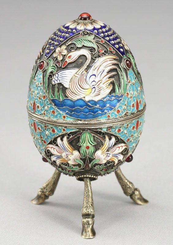 23: Russian silver and enameled egg depicting swans