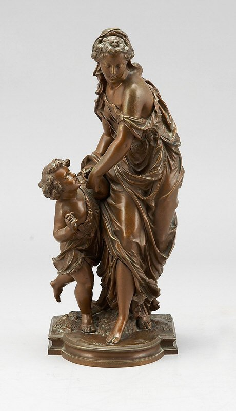 23: A patinated bronze sculpture of a maiden and child