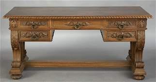 267: A Renaissance Revival carved oak library table