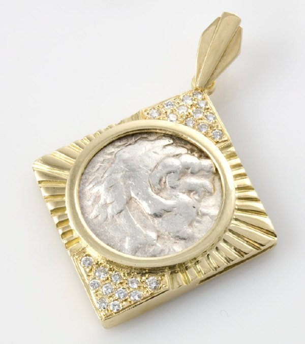 6: 18K gold and diamond coin pendant with chain