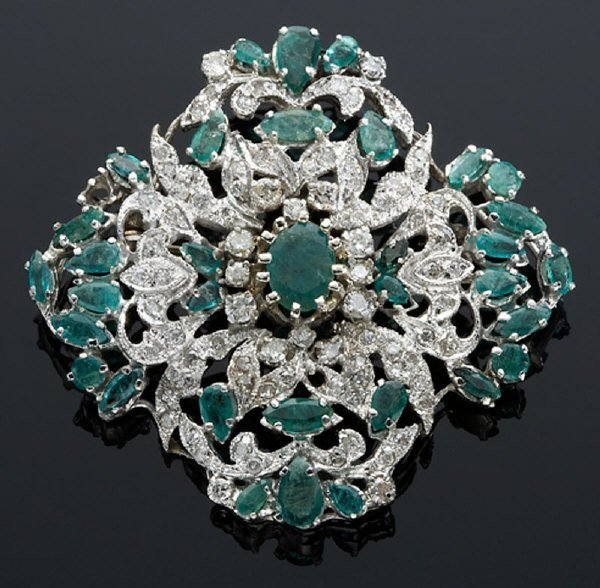 15: 14K white gold, diamond and emerald brooch