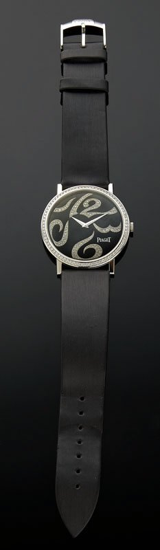5: Piaget Altiplano 18K and diamond watch with an