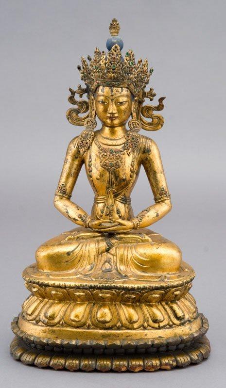 238: Chinese Tibetan gilt bronze Buddha on wood stand
