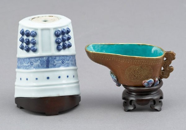 340: A Chinese porcelain libation cup and a bell