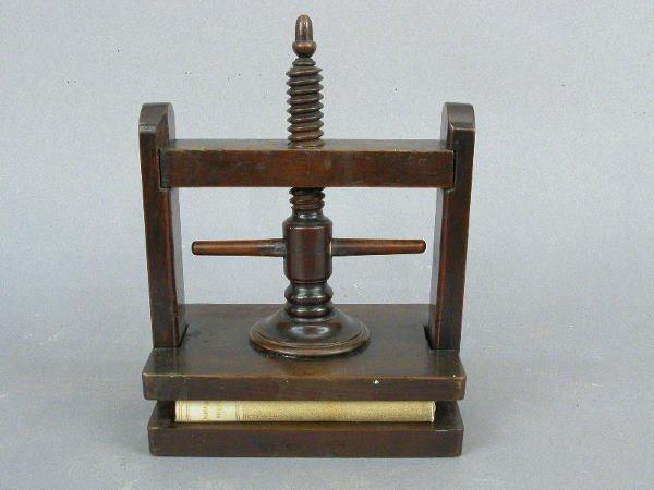 1: A miniature English mahogany book press.