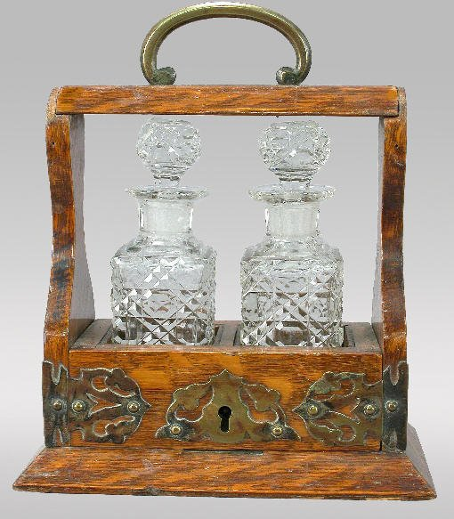 2: A miniature decanter set in a sliding