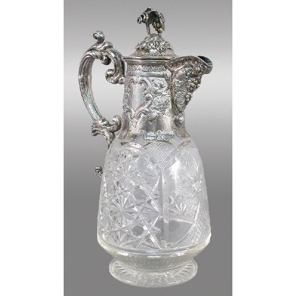 11: A repousse silverplate and cut glass ewer