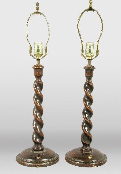 18: Pair of English oak barley twist candlesticks