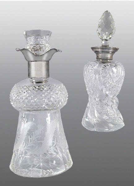 19: (2) English cut glass decanters with sterling