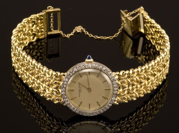 7: 18K gold and diamond Audemars Piguet ladies watch