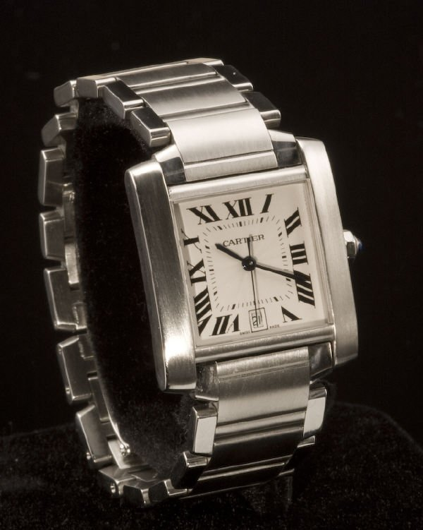 21: Midsize Cartier stainless steel tank watch.