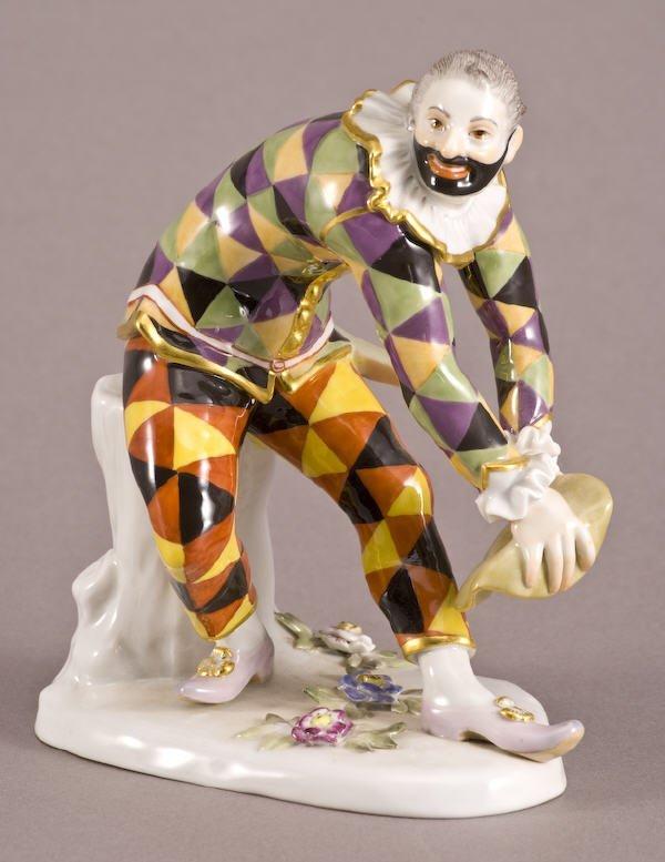 2: A Meissen porcelain figure modeled as a masked