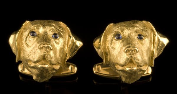 4: Pair 18K gold cuff links shaped like the face of