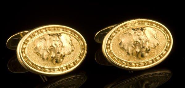 10: Whiteside 18K gold elephant cufflinks.
